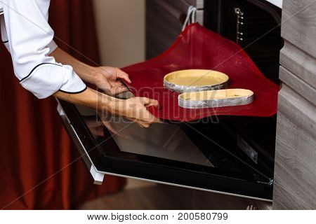 The Confectioner Puts The Biscuit Into The Oven