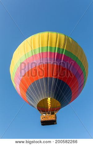 Hot air baloon in blue sky close-up
