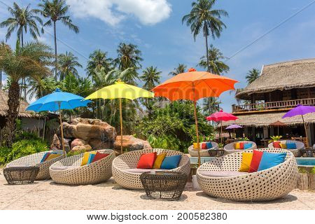 Tropical resort with a swimming pool and cafe bar on Koh Kood island, thailand