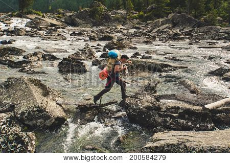 Young Man Crossing Mountain River.