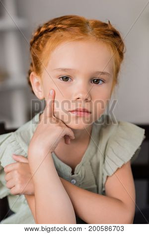 close-up portrait of beautiful thoughtful little girl