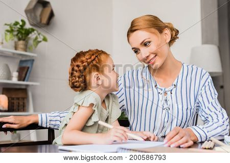 Loving Mother Looking At Daughter