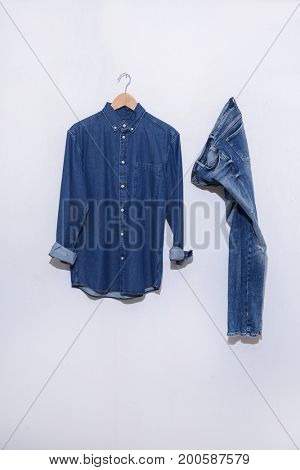shirt in hanging and blue denim jean on hanging isolated