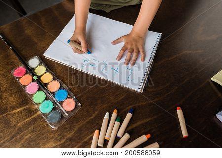 Child Writing Math Exercise