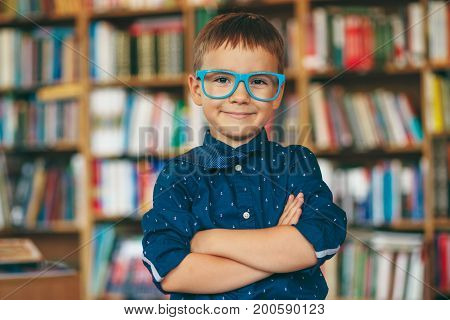 Boy With Glasses In Library