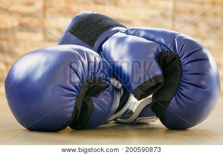 blue Boxing gloves on the floor clouse up