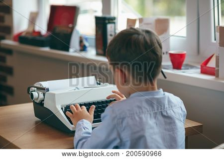Boy With Typewriter