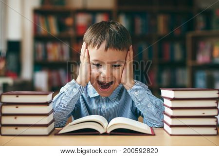 Boy Reading With Enthusiasm