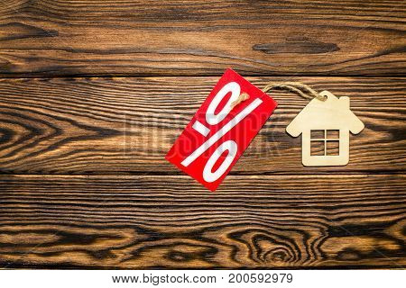 Symbol of a house on a brown wooden background