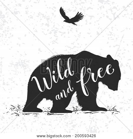 Silhouette of a wild bear and calligraphy. Wild life in nature.