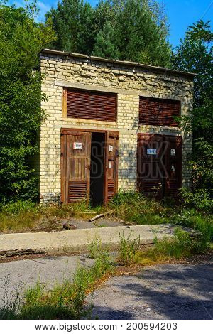 The abandoned building of the transformer substation. Dead military unit. Consequences of the Chernobyl nuclear disaster August 2017.