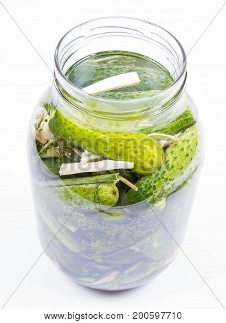 Brined pickles in a jar, with garlic, dill and horseradish