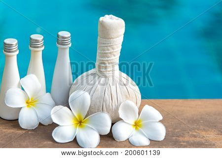 Thai Spa massage compress balls herbal ball and treatment spa relax and healthy care with frangipani white flower Thailand. Healthy Concept.