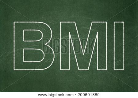 Healthcare concept: text BMI on Green chalkboard background