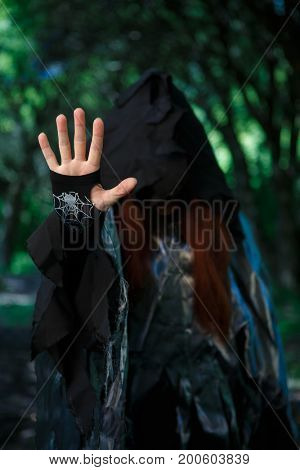 Photo of witch in hood