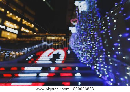 Image of night festival on street blurred background with bokeh bulb lighting twilight concept of chrismas lighting.