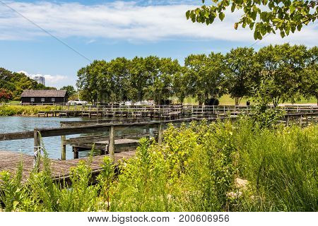Trees surround the boat dock on Lake Trashmore, one of two lakes at Mount Trashmore Park, a former landfill in Virginia Beach, Virginia, which was converted to a city park in 1974.