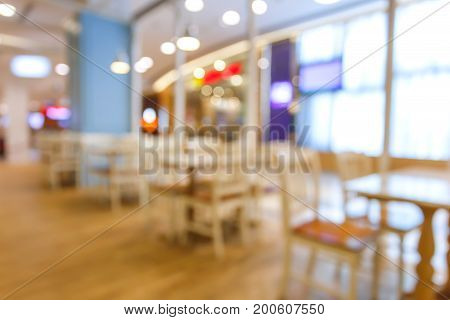 Blurred or Defocus image table dinner in restaurant or food center with bokeh.
