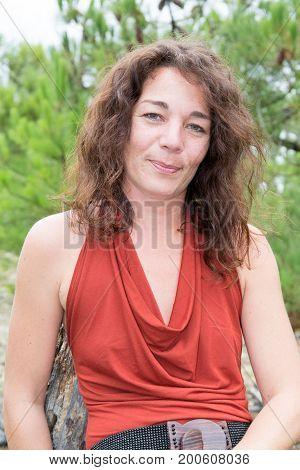 a brunette Portrait hispanic fore woman outdoors