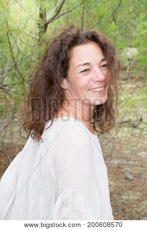 a Young Woman Outdoors smiling and happy