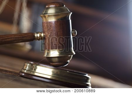 Law theme. Mallet and scale in court library.