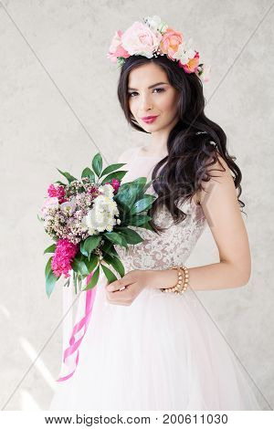 Pretty Fashion Model with Flowers. Girl in Lacy Dress