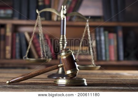 Lawyer theme. Judge wooden gavel and golden scale of justice. Place for typography.
