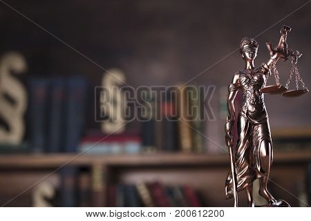 Law symbols. Statue of justice on wooden table.