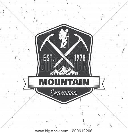 Mountain expedition badge. Vector illustration. Concept for shirt or logo, print, stamp or tee. Vintage typography design with ice axe, mountaineer and mountain silhouette. Outdoors adventure emblem.