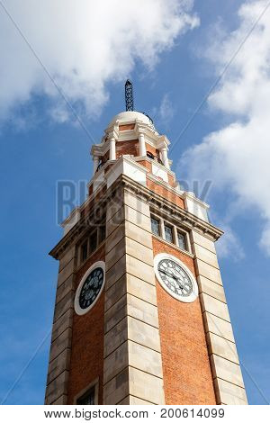 Close up of Hong Kong's landmark clock tower at Tsim Sha Tsui Kowloon near Victoria Harbor. The tower has been listed as a declared monument by the Hong Kong government since 2000.