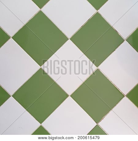 White and Green tiles from a tiled stove framed tiled floor pattern background small square