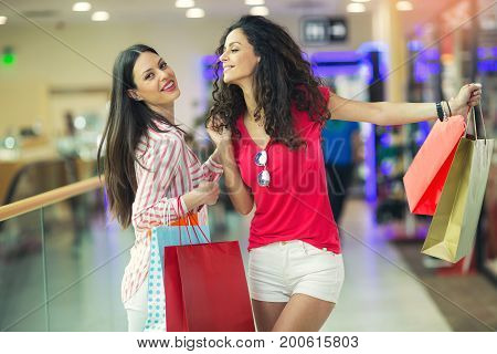 Happy woman at a shopping mall with bags