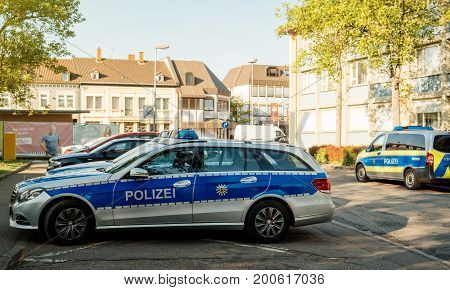 KEHL GERMANY - APR 28 201: Modern Polizei Police car Mercedes-Benz blue car parked in front of Police Station in center of the city of Kehl Germany