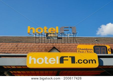 PARIS FRANCE - APR 28 2017: Hotel Formula 1 signage on the roof of a cheap hotel. Hotel Formule 1 or hotelF1 in France is an international chain of