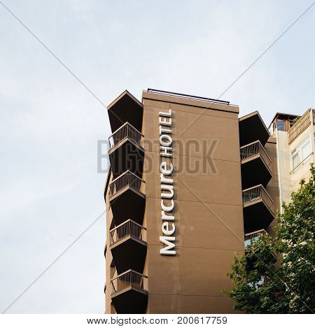 BARCELONA SPAIN - JUN 26 2016: Mercure Hotel logotype on the impressive building in Barcelona Spain. Mercure Hotels is a brand of hotels run by French multinational corporation AccorHotels