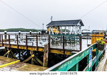 Empty Wooden Marina Harbor In Small Village In Castine, Maine During Rain