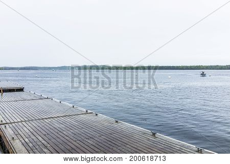 Empty Boat On Wooden Deck Or Pier Harbor In Small Village In Castine, Maine During Rain