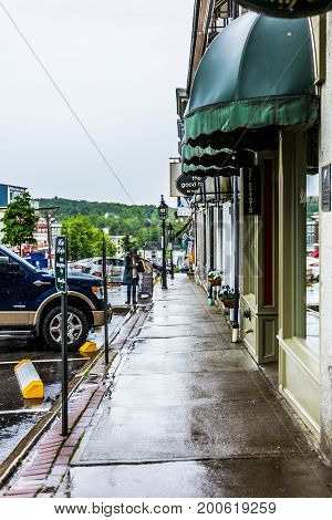 Belfast, Usa - June 9, 2017: Empty Small Village In Maine During Rain With Buildings And Stores On M