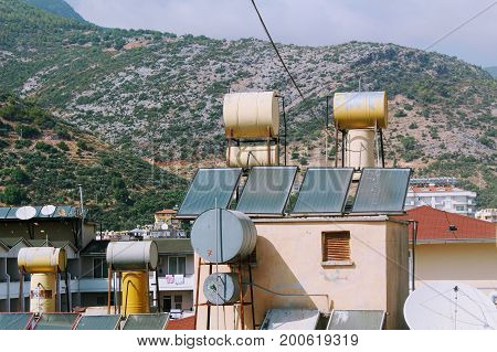 Alanya, Turkey, July 2017: barrels for natural water heating on the roof of the hotel.