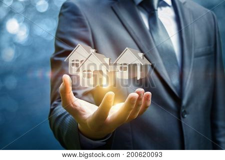 Houses In Hand Businessman .