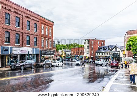 Camden, Usa - June 9, 2017: Downtown Small Village In Maine During Rain With Person Walking Carrying