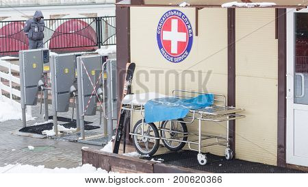 Sochi - March 28 2017: Rescue service building in the mountains and a stretcher for the injured and skiers stand near the entrance and snow around March 28 2017 Sochi Russia