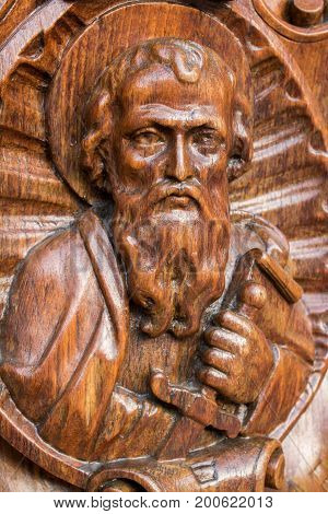 Wooden statue of St. Paul looking upwards.