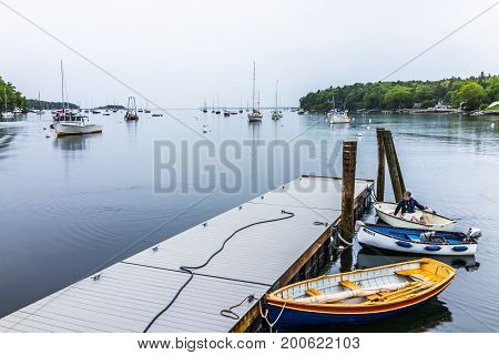 Rockport, Usa - June 9, 2017: Marina Harbor In Small Village In Maine During Rain With Man On Rowboa