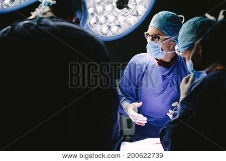 Group Of Doctors At Work In Hospital Operation Theater