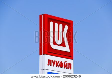 Logo Of The Company Lukoil. Gas Station Of The Oil Company Lukoil On The Highway.