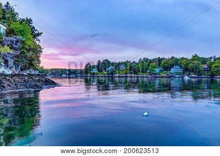 Sunset In Evening At Boothbay Harbor In Small Village In Maine With Rocky Coast And Houses