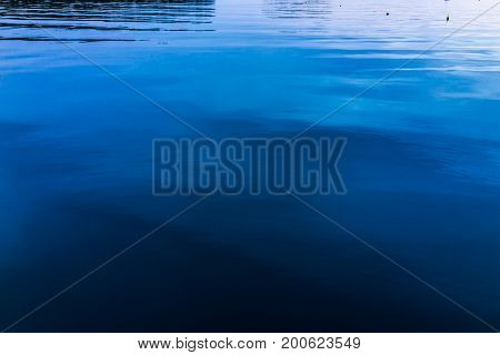 Sunset In Evening At Boothbay Harbor In Small Village In Maine With Closeup Of Smooth, Dark Water
