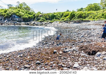 Cape Elizabeth, Usa - June 10, 2017: Boy Running Away From Wave On Rocky Public Beach Called Ship Co