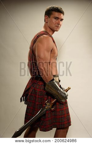 The tough guy is wearing his highlander outfit.